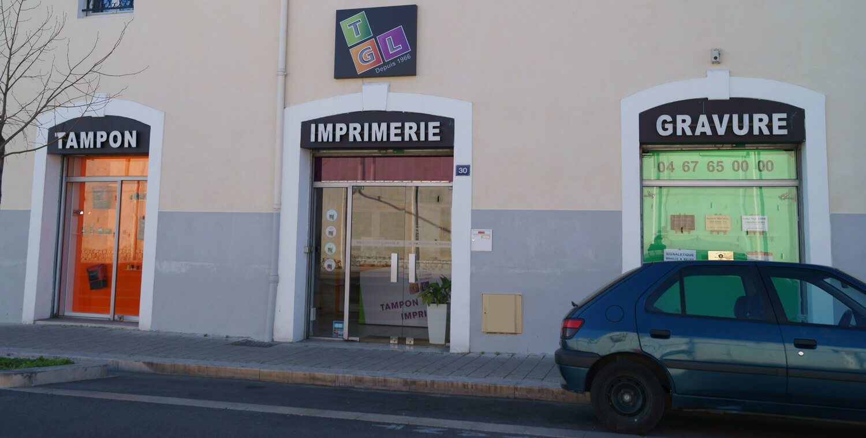 Façade du magasin de tampons et plaques TGL Montpellier